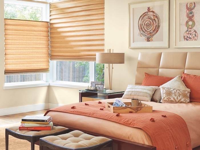 A bedroom with copper tray and copper-colored bedding.